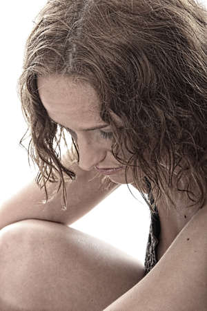 Abused young woman dramatic portrait photo