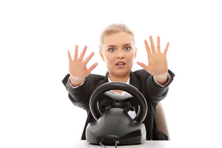 Young caucasian business woman playing on computer (with steering wheel), isolated on white background photo