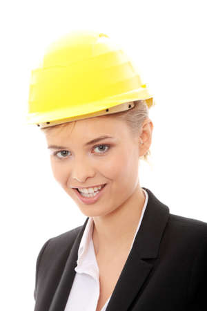 sexy construction worker: Portrait of confident female worker in helmet isolated on white background