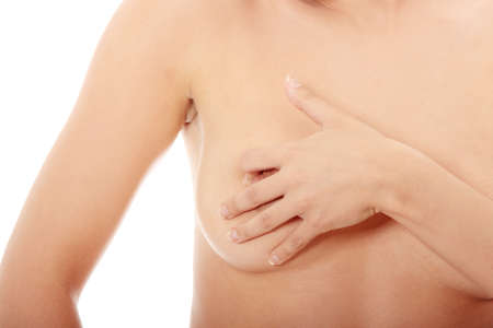Young Caucasian adult woman examining her breast for lumps or signs of breast cancer Stock Photo - 9017783