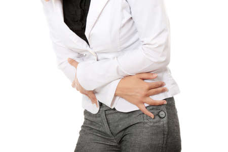 stomachache: Woman with stomach issues isolated on white background