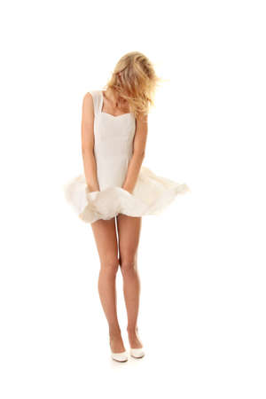 Blond sexy woman in white skirt blowed by wind, isolated on white background Stock Photo - 9001127