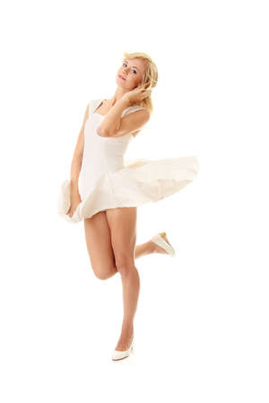 Blond sexy woman in white skirt blowed by wind, isolated on white background photo