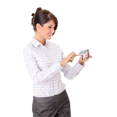 Young businesswoman  (real estate agent) with hose model and keys photo