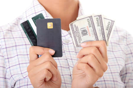 Woman with a credit card and cash on her hand Stock Photo - 9021257