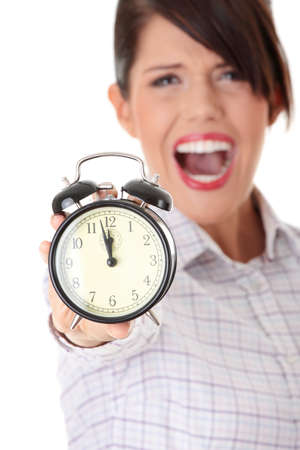 A young business woman with alarm clock isolated photo