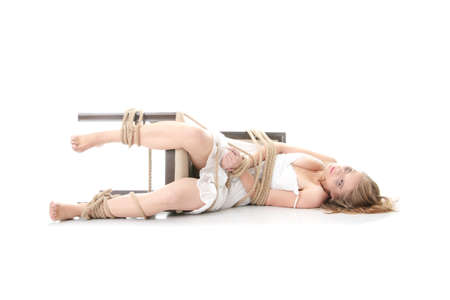 female wrestling: The beautiful blond girl tied with rope - kidnapping concept