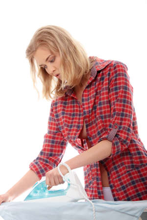 warm shirt: Happy young woman ironing on ironing board,isolated on white background.