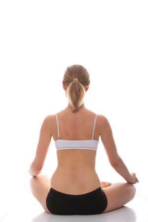 Young woman doing yoga exercise, isolated on white background Stock Photo - 9001290