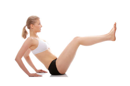 Young woman doing yoga exercise, isolated on white background Stock Photo - 9001120