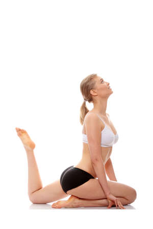 Young woman doing yoga exercise, isolated on white background Stock Photo - 9001333