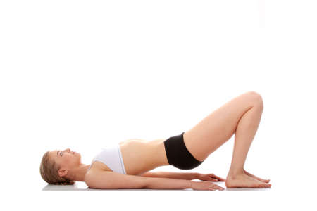Young woman doing yoga exercise, isolated on white background Stock Photo - 9001114