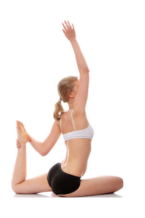 Young woman doing yoga exercise, isolated on white background Stock Photo - 9001301