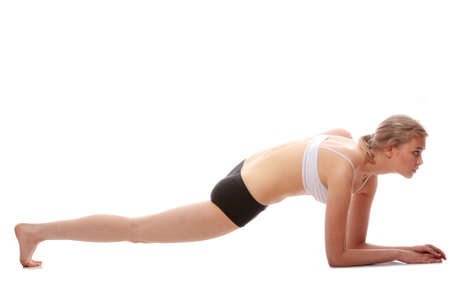 Young woman doing yoga exercise, isolated on white background Stock Photo - 9001115