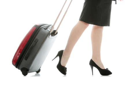Businesswoman legs with a suitcase on the white background  Stock Photo - 9008053