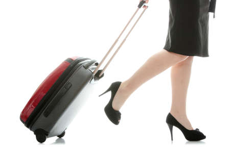 travel luggage: Businesswoman legs with a suitcase on the white background