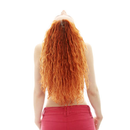 Rear view of the young female with beauty curly long hairs - on a white  photo