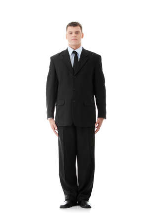 Full length of a handsome business man standing against white background photo