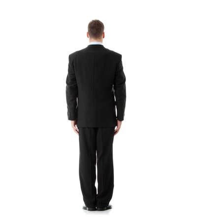 Full lenght portrait of businessman standing back, isolated Stock Photo - 9002681