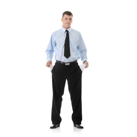 Sad and broke business man with empty pockets photo