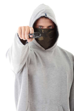 Criminal theme - masked man with gun, isolated on white photo