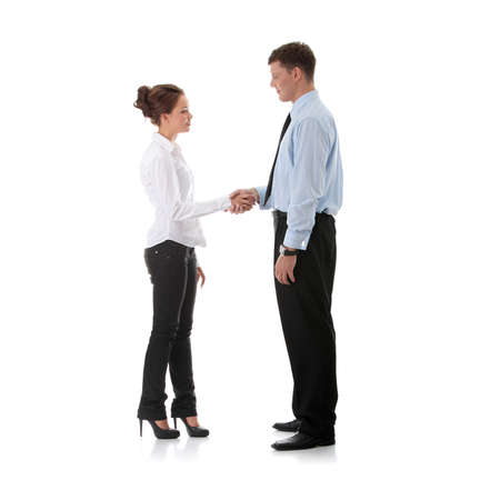 eachother: Successful young business executives shaking hands with eachother