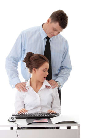 Molestation at work concept. Man molestating woman photo