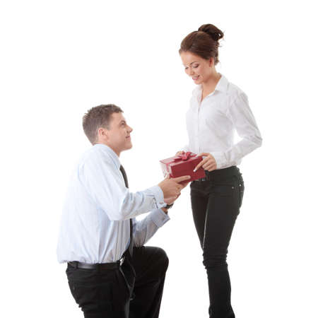 Business man offering a gift to a woman, isolated on white Stock Photo - 9013465