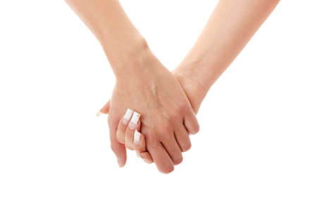 touching hands: Two woman holding their hands isolated on white background