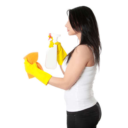 Woman with sponge and spray. Isolated on white background photo