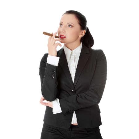 Businesswoman (boss) with cigar (feminism concept) photo
