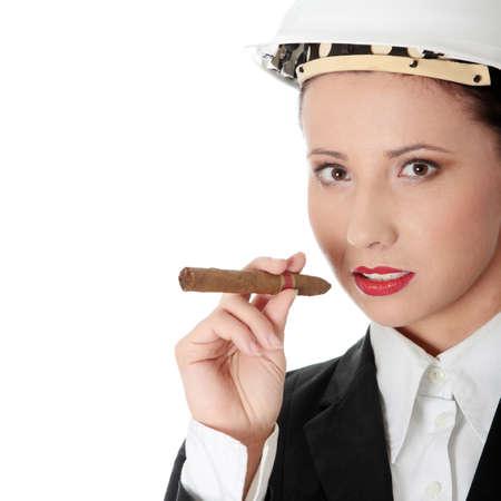 feminismo: Empresaria (jefe) con cigar (concepto de feminismo)