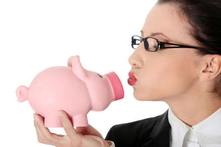 Businesswoman holding piggy bank isolated on white photo