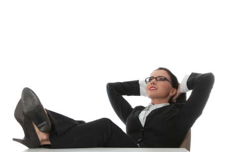 adult's feet: Young beautiful business woman having a rest at the working place. Stock Photo