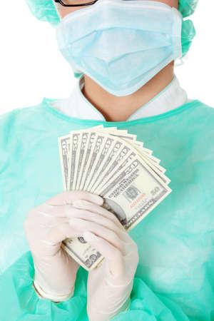 Female surgeon doctor holding money , isolated on white background  photo