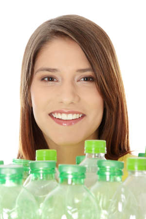 Young woman carrying a plastic container full with empty recyclable plastic. Recycling concept photo