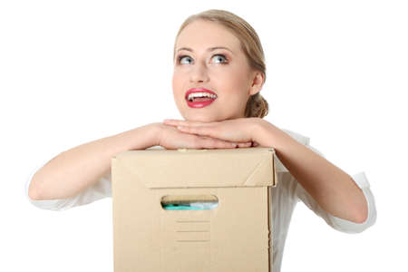 Young pretty woman with hands and head on the big box with documents  photo