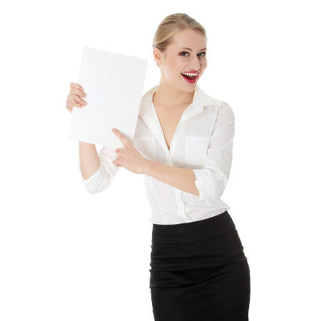 Young business woman holding empty piece of paper  Isolated on white  photo