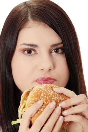 Beautiful caucasian woman eating hamburger. Isolated on white photo