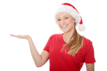 Santa Girl presenting your product, isolated on white background photo