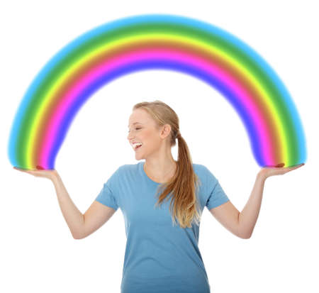 Young woman holding rainbow, isolated on white photo