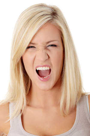 A frustrated and angry woman is screaming out loud. Stock Photo - 9022848