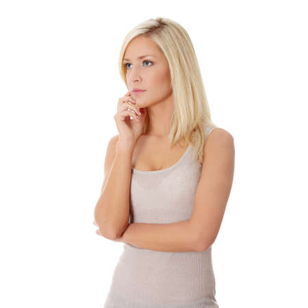 Thoughtful woman, isolated over a white background photo
