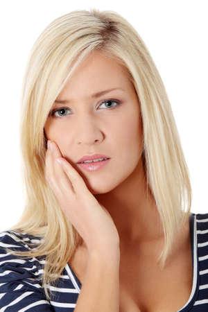 mal di denti: Giovane donna nel dolore sta avendo mal di denti isolated on white Archivio Fotografico