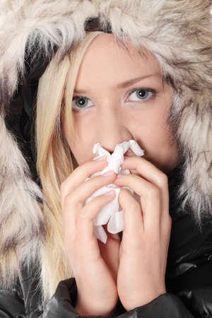 Woman holding tissue and sneezing isolated on white background photo