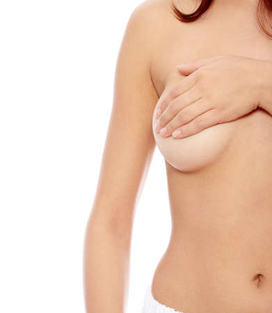 Topless woman body covering her breast with hand, isoalted on white. Breast cancer concept  Stock Photo - 9018081
