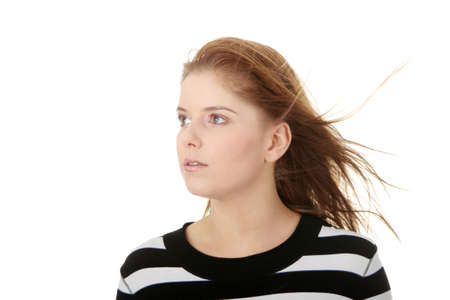 Young woman with wind in her hairs, isolated on white background  photo