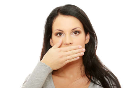 Young woman covering her mouth, isolated on white