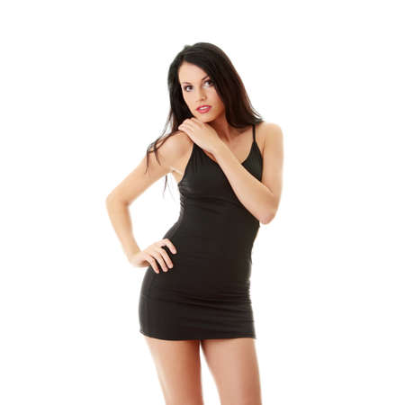 Pretty brunette woman wearing sexy dress, isolated on white background Stock Photo - 9004643