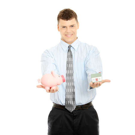 corporate greed: Young business person encourage saving money. Holding house model and piggy bank